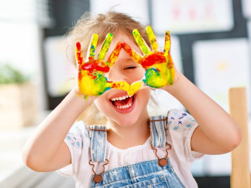 Young girl with painted hands